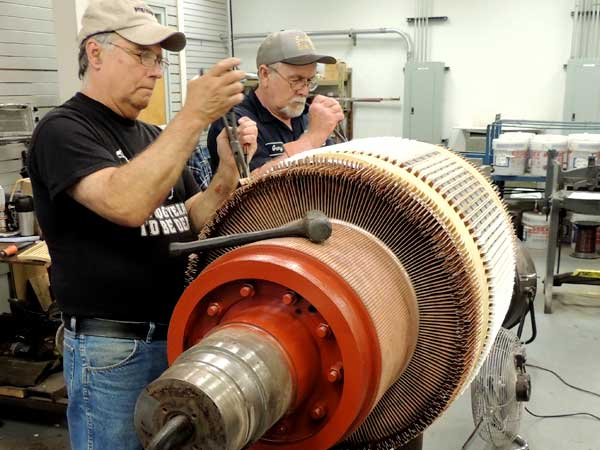 Illiana Technicians Rewinding Spindle